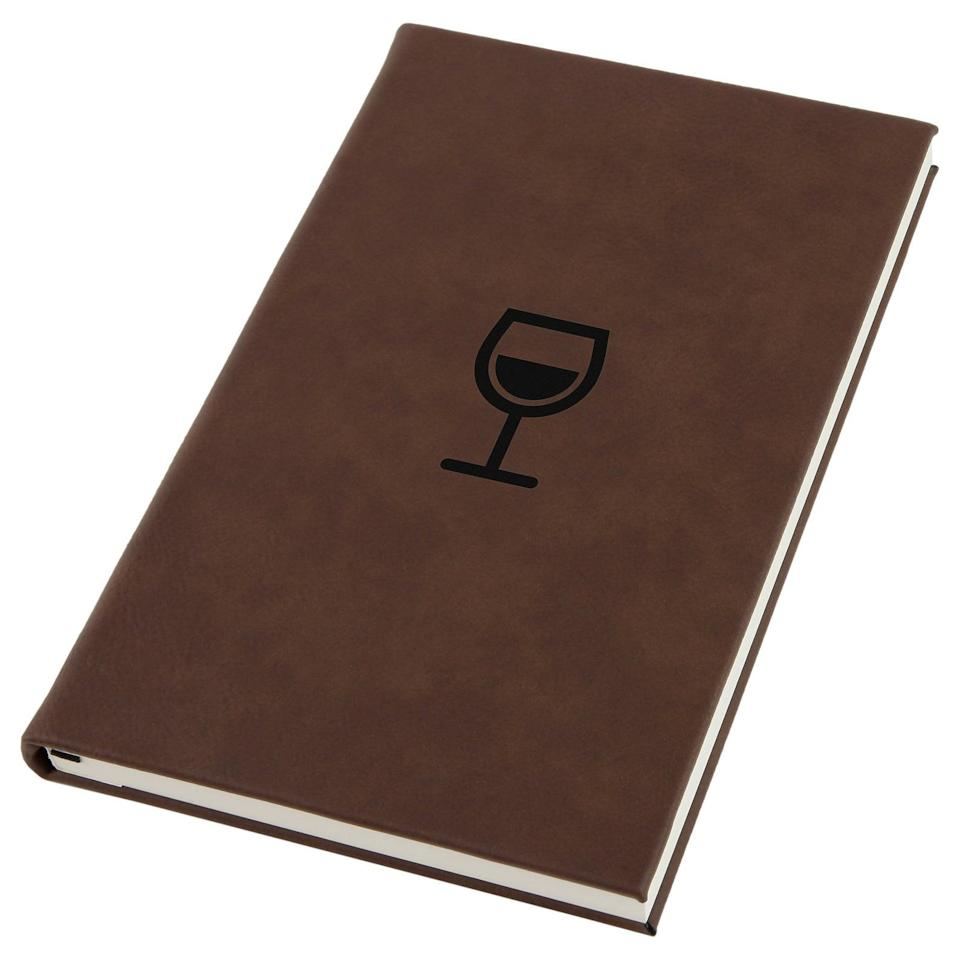 <p>For the wine aficionado, this <span>Wine Glass Engraved A5 Leatherette Journal</span> ($20) lets them keep track of all their favorite bottles.</p>