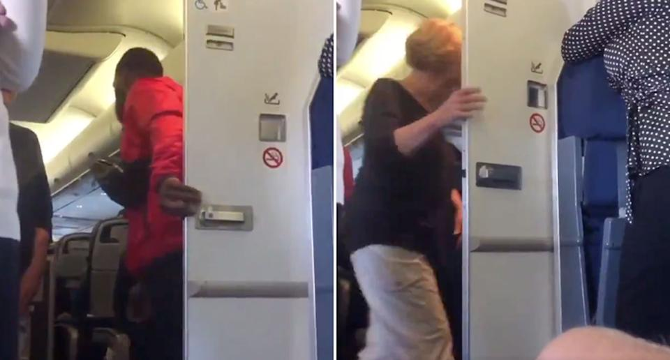A man walks out of a passenger plane bathroom before a woman walks in.