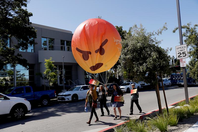 Demonstrators carry an inflatable angry emoji during a protest outside the Facebook 2019 Annual Shareholder Meeting in Menlo Park, California, U.S., May 30, 2019. REUTERS/Stephen Lam