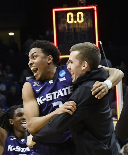 Kansas State guard Kamau Stokes (3) celebrates a win over Kentucky after a regional semifinal NCAA college basketball tournament game, Friday, March 23, 2018, in Atlanta. Kansas State won 61-58. (AP Photo/John Amis)