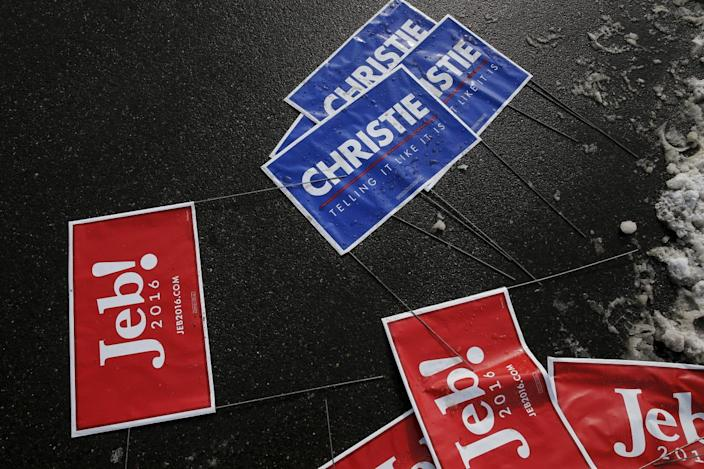 <p>Election signs for Republican Presidential candidates Jeb Bush and Chris Christie are pictured on the ground on voting day in Bedford, New Hampshire, February 9, 2016. <i>(Photo: Carlo Allegri/Reuters)</i></p>