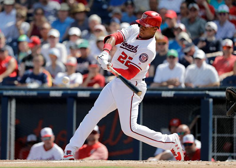 Washington Nationals' Juan Soto bats during the first inning of an exhibition spring training baseball game against the Houston Astros Sunday, March 3, 2019, in West Palm Beach, Fla. (AP Photo/Jeff Roberson)