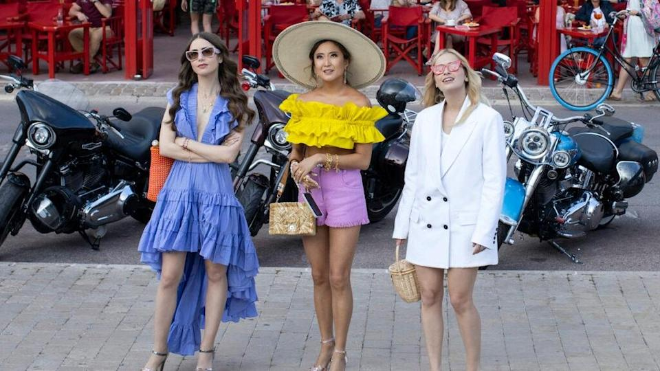 Emily in Paris. (L to R) Lily Collins as Emily, Ashley Park as Mindy, Camille Razat as Camille in episode 202 of Emily in Paris. Cr. Carole Bethuel/Netflix © 2021