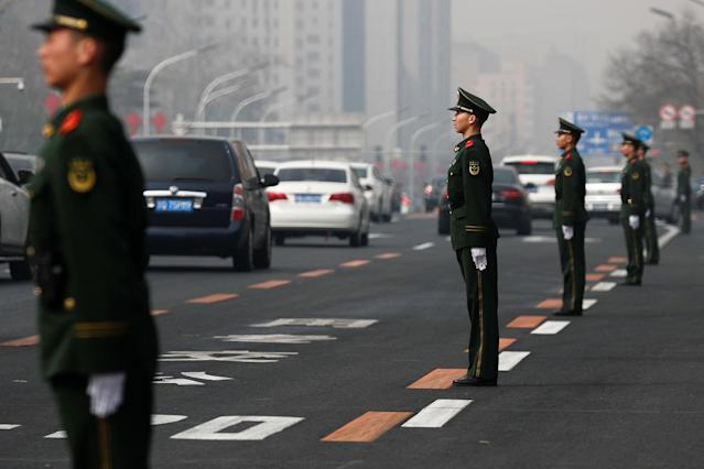 <p>Security personnel take position along Beijing's main east-west thoroughfare, Changan Avenue, in Beijing, China, March 27, 2018. (Photo: Damir Sagolj/Reuters) </p>