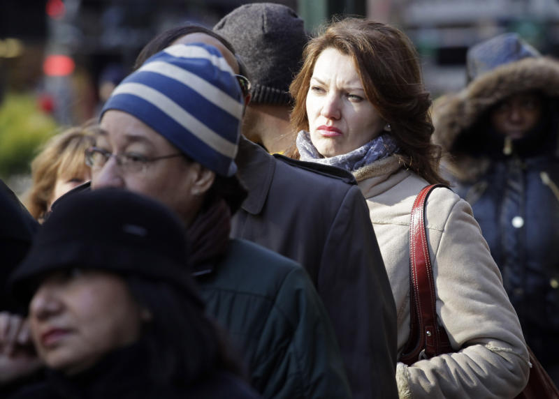 "Rasa Pasaliene waits in line to attend a job fair, Dec. 8, 2010 in New York. Pasaliene, who is currently employed, is looking for a job in healthcare that will pay her more money. ""I'm struggling with my mortgage payments now,"" she said. (AP Photo/Mark Lennihan)"