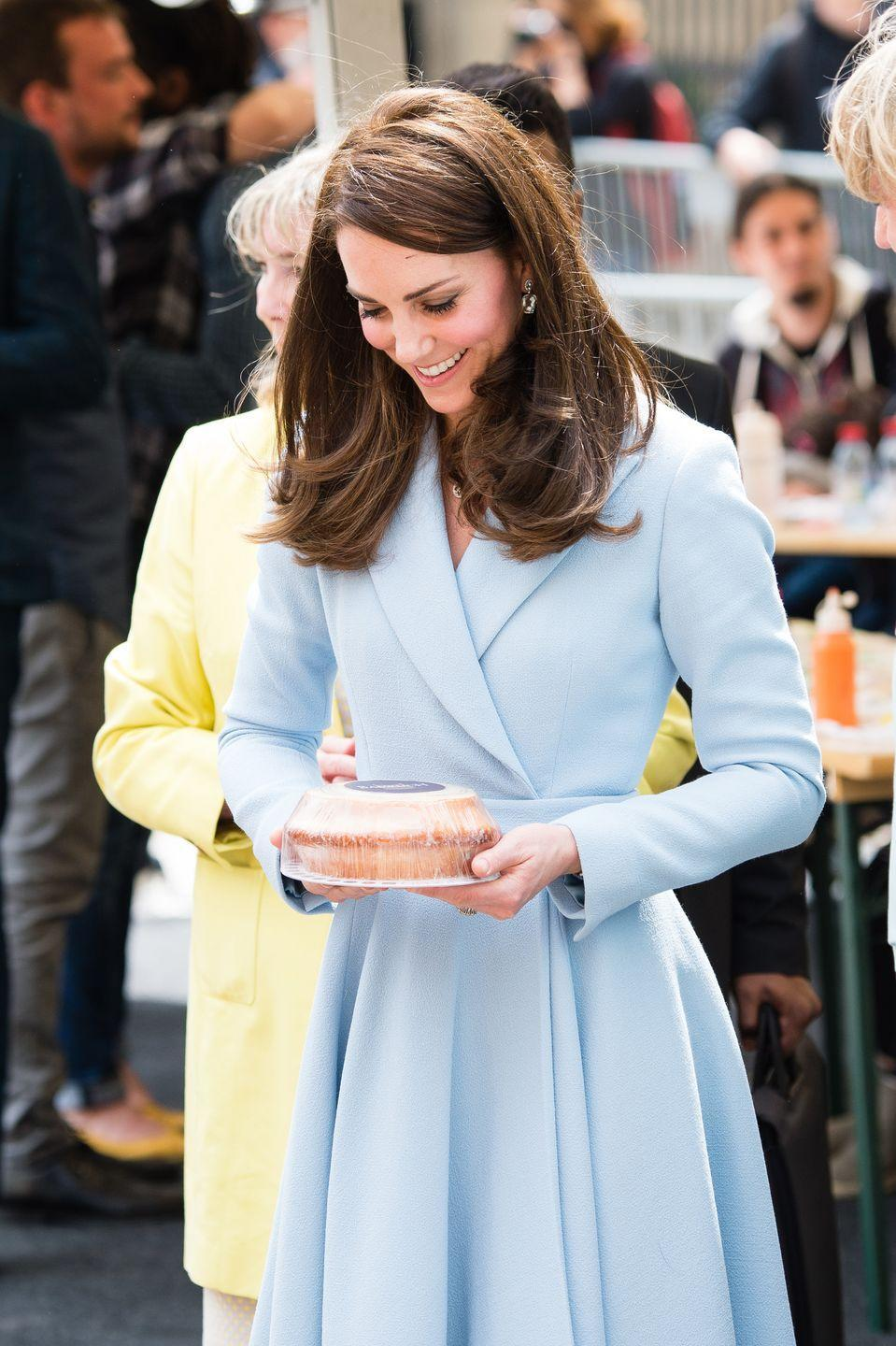 <p>Kate sweetly smiled at a cake presented to her as she toured a cycling-themed festival in Luxembourg. </p>