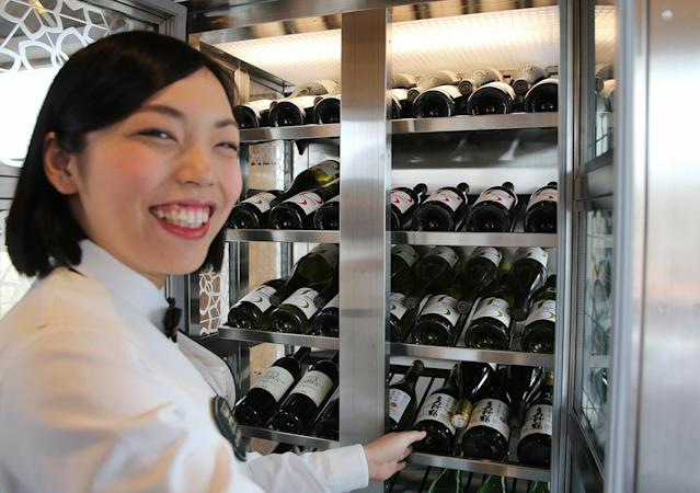 "<p>Guests can choose from a variety of wines and spirits in the dining car's ""wine cellar."" (Photo: Asahi Shimbun via Getty Images) </p>"