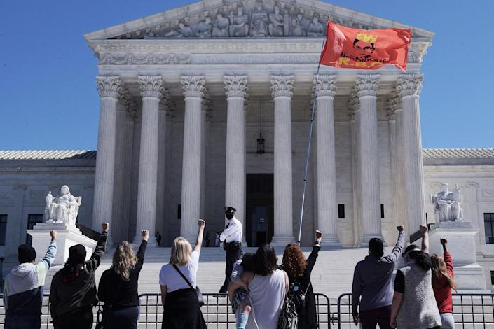 Supporters thronged the steps of the court Sept.21 for an impromptu vigil honoring the late Justice