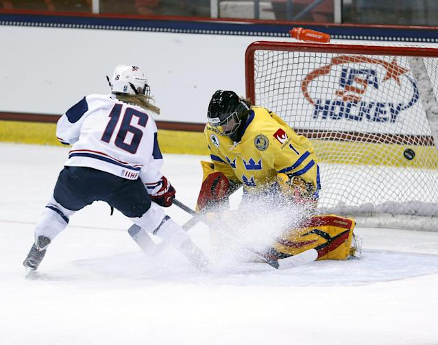 USA's Kelli Stack (16) scores a goal past Sweden goalie Sara Grahn (1) during the second period of a Four Nations Cup women's hockey game on Tuesday, Nov. 5, 2013, in Lake Placid, N.Y. (AP Photo/Mike Groll)