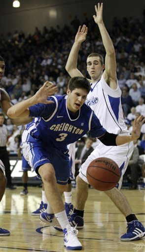 Creighton forward Doug McDermott (3) eyes a loose ball in front of Drake forward Aaron Hawley, right, during the first half of an NCAA college basketball game, Wednesday, Jan. 25, 2012, in Des Moines, Iowa. (AP Photo/Charlie Neibergall)