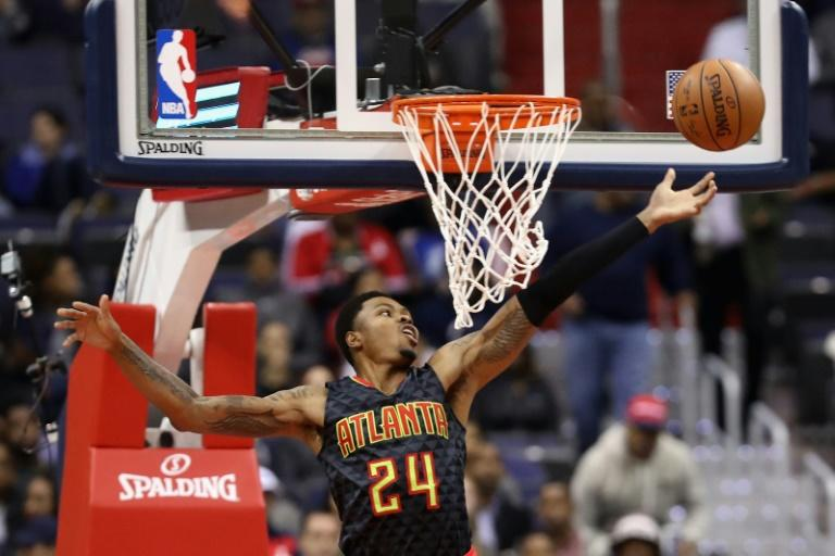 Kent Bazemore of the Atlanta Hawks looses the ball going up for a shot during a NBA game in Washington, DC