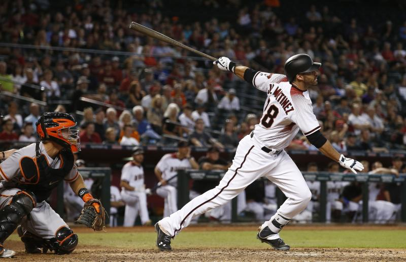 J.D. Martinez has helped propel the Diamondbacks to the postseason. (AP)
