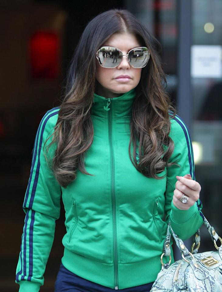 """Fergie is fabulous, as is her retro track jacket, but the Black Eyed Peas songstress' bug-like specs are a bit scary. Don'tcha think? <a href=""""http://www.infdaily.com"""" target=""""new"""">INFDaily.com</a> - June 1, 2010"""