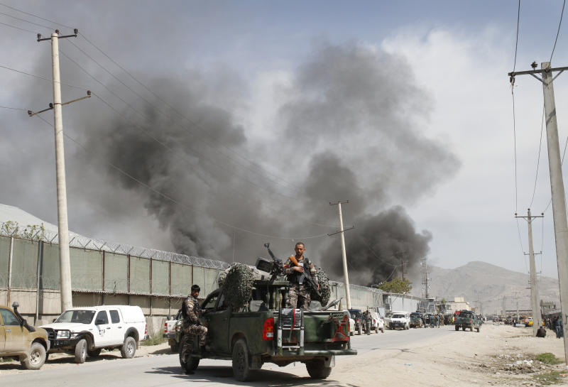 Smoke billows out from a compound after it was attacked by militants in Kabul, Afghanistan, Wednesday, May 2, 2012. Taliban insurgents attacked a compound housing foreigners in the Afghan capital Wednesday, killing seven people, hours after President Barack Obama made a surprise visit and signed a pact governing the U.S. presence after combat troops withdraw. (AP Photo/Musadeq Sadeq)