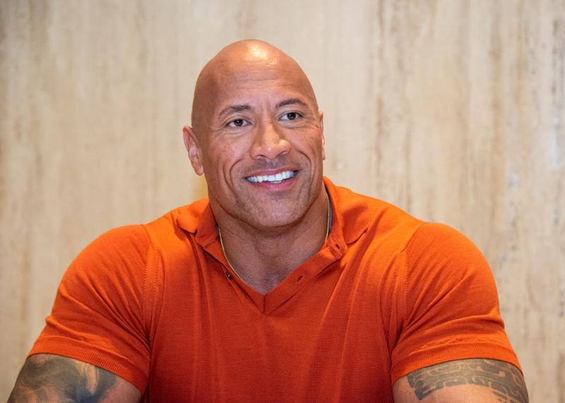 "Dwayne ""The Rock"" Johnson has an adorable way of helping his daughter wash her hands. (Photo: Vera Anderson/WireImage)"