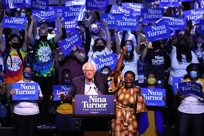 CLEVELAND, OHIO - JULY 31: Sen. Bernie Sanders (I-VT) raises the hand of Congressional Candidate Nina Turner during a Get Out the Vote rally at Agora Theater & Ballroom on July 31, 2021 in Cleveland, Ohio. Congressional Candidate Nina Turner was joined by Sen. Bernie Sanders (I-VT), Minnesota Attorney General Keith Ellison, and Dr. Cornell West for a GOTV campaign rally on the final weekend of early voting before Tuesdays Primary Special Election for Ohio's 11th Congressional District primary were Turner and Cuyahoga Councilwoman Shontel Brown are the frontrunners ahead of 11 other Democratic candidates in the race. The rally was followed by a march to the Board of Elections office. The special election was triggered after former Rep. Marcia Fudge, joined the Biden administration to become the U.S. Secretary of Housing and Urban Development. (Photo by Michael M. Santiago/Getty Images)