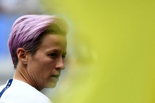 "President Donald Trump accuses US women's World Cup soccer star Megan Rapinoe of ""disrespect"" after she swore never to visit his White House (AFP Photo/FRANCK FIFE)"