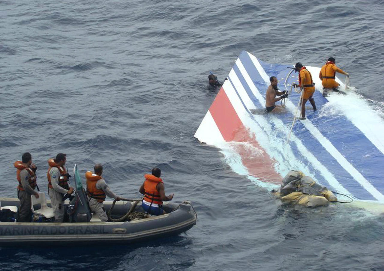 FILE - This Monday, June 8, 2009 file photo released by Brazil's Air Force shows Brazil's Navy sailors recovering debris from the missing Air France jet at the Atlantic Ocean. Officials say flight recorders from an Air France plane that crashed nearly two years ago show that the captain only arrived in the cockpit after the plane had begun its fateful 3 1/2-minute descent. The initial findings of the French air accident investigation agency, the BEA, based on a reading of the so-called black boxes recovered from the ocean depths, found that the captain had been resting when the emergency began. All 228 aboard the Rio de Janeiro to Paris flight were killed on June 1, 2009.