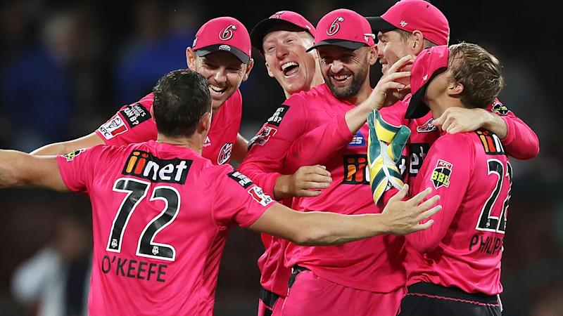 The Sydney Sixers are pictured celebrating winning the 2019/20 Big Bash League.
