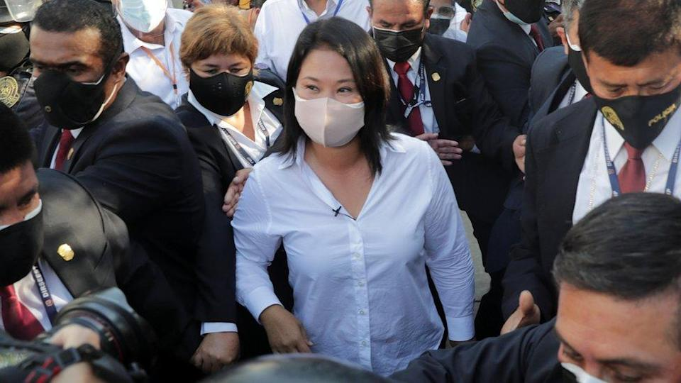 Presidential candidate Keiko Fujimori leaves the polling station after voting
