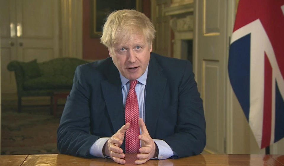 In this screen grab taken from video, Britain's Prime Minister Boris Johnson addresses the nation from 10 Downing Street, in London, Monday March 23, 2020. Johnson has ordered the closure of most retail stores and banned gatherings for three in a stepped-up response to slow the new coronavirus. The measures Johnson announced in an address to the nation on Monday night a mark a departure from the British government's until-now more relaxed approach to the worldwide COVID-19 pandemic. (UK Pool via AP)