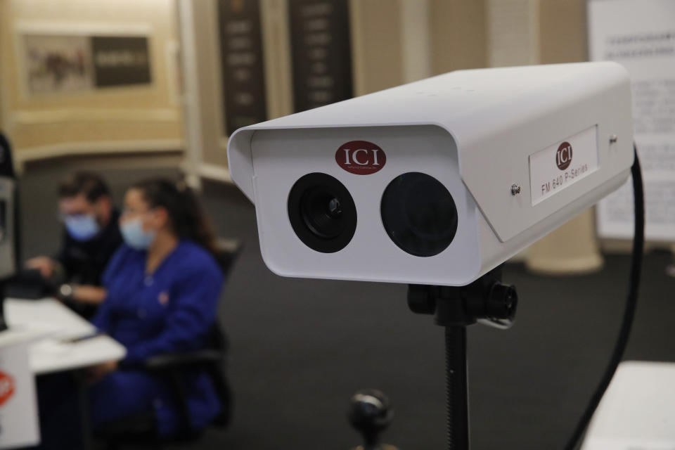 An infrared camera used to measure employee's temperatures is set up at an employee entrance during a closure due to the coronavirus at the Bellagio hotel and casino, Wednesday, May 20, 2020, in Las Vegas. Casino operators in Las Vegas are awaiting word when they will be able to reopen after a shutdown during the coronavirus outbreak. (AP Photo/John Locher)