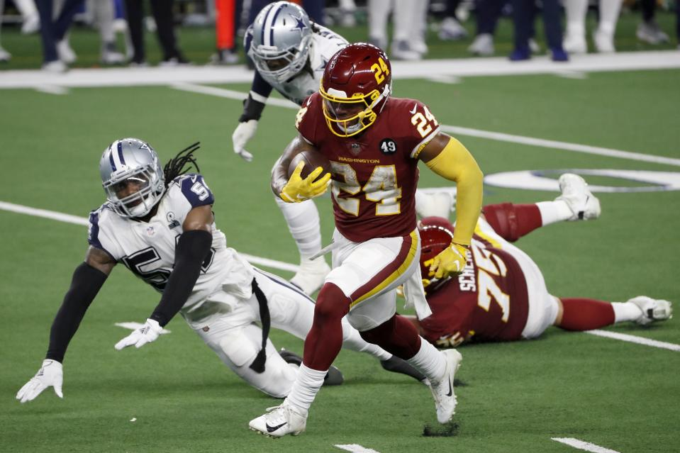 Washington Football Team running back Antonio Gibson (24) sprints to the end zone past Dallas Cowboys linebacker Jaylon Smith (54) for a touchdown in the second half of an NFL football game in Arlington, Texas, Thursday, Nov. 26, 2020. (AP Photo/Roger Steinman)