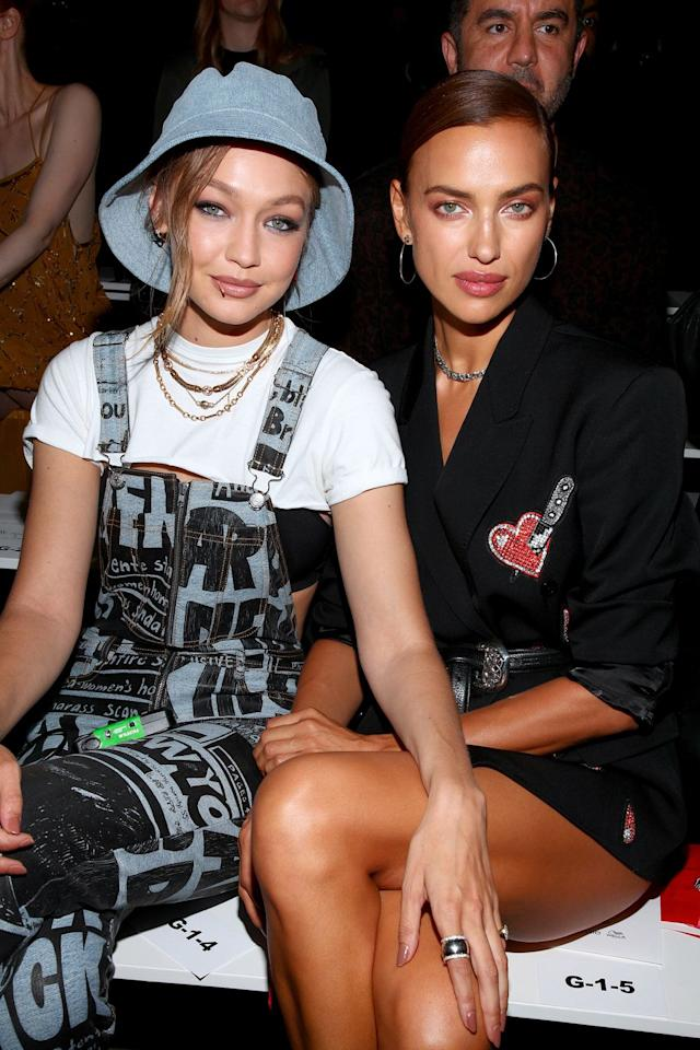 <p>Hadid, wearing a denim bucket hat and necklaces by Missoma, snuggled up to Shayk whilst cheering on their friend Jeremy Scott at his SS20 show in New York.</p>