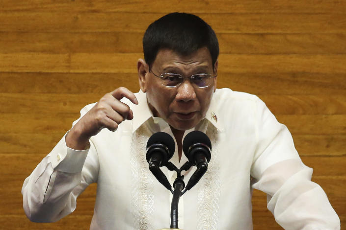 Philippine President Rodrigo Duterte gestures as he delivers his final State of the Nation Address at the House of Representatives in Quezon City, Philippines on Monday, July 26, 2021. Duterte delivered his final State of the Nation speech Monday before Congress, winding down his six-year term amid a raging pandemic, a battered economy and a legacy overshadowed by a bloody anti-drug crackdown that set off complaints of mass murder before the International Criminal Court. (Lisa Marie David/Pool Photo via AP)