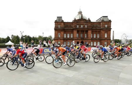 2018 European Championships - Road Cycling, Road Race Women - Glasgow, Britain - August 5, 2018 - Cyclists ride past People's Palace in Glasgow Green. REUTERS/Peter Cziborra