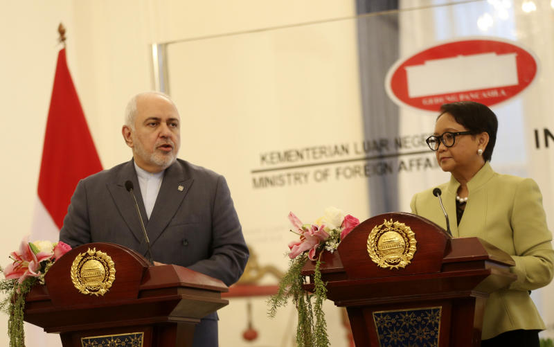 Iran's Foreign Minister Mohammad Javad Zarif, left, talks to journalist during a joint press conference with his Indonesian counterpart Retno Marsudi, right, after their meeting in Jakarta, Indonesia, Friday, Sept. 6, 2019. (AP Photo/Achmad Ibrahim)