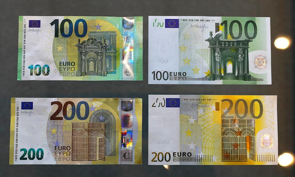 The new 100 and 200 Euro banknotes (L) are presented in comparison to the old banknotes at the headquarters of Germany's Federal reserve Bundesbank in Frankfurt, Germany, May 21, 2019.  REUTERS/Kai Pfaffenbach