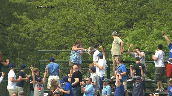 Wife douses husband with beer in Wrigley Field bleachers after he tries to protect her from homer
