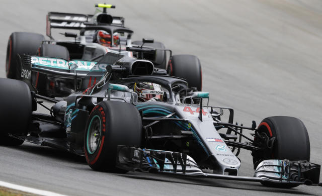 Mercedes driver Lewis Hamilton, of Britain, steer his car ahead of Hass driver Kevin Magnussen of Denmark, during the first free practice at the Interlagos race track in Sao Paulo, Brazil, Friday, Nov. 9, 2018. (AP Photo/Nelson Antoine)