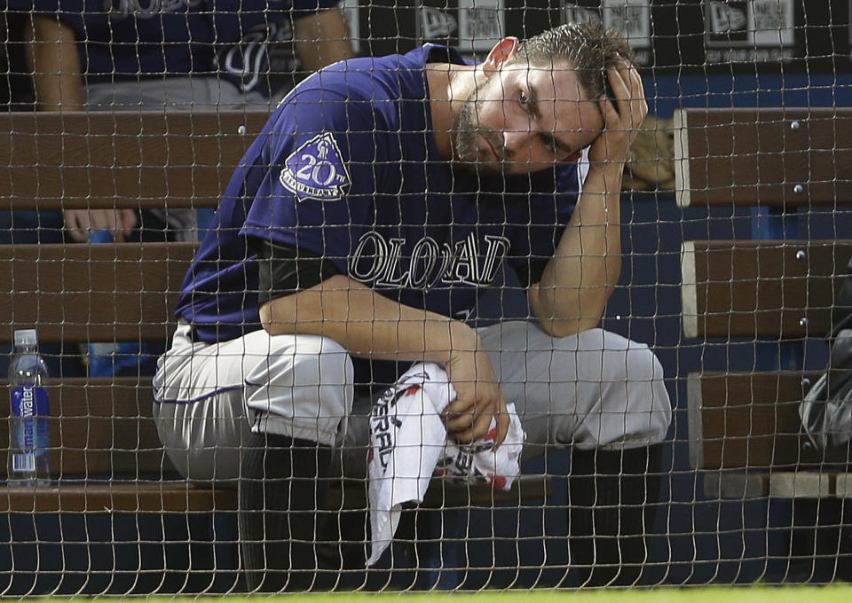 Colorado Rockies starting pitcher Tyler Chatwood sits in the dugout after being pulled in the third inning of a baseball game against the Atlanta Braves in Atlanta, Wednesday, July 31, 2013. (AP Photo/John Bazemore)
