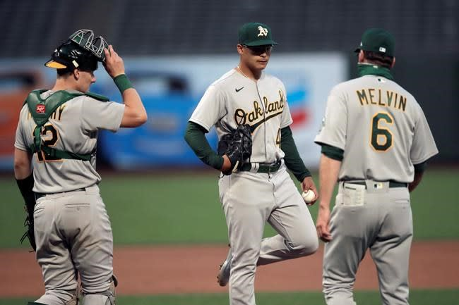 Piscotty slam ties it in ninth, A's beat Giants 8-7 in 10th