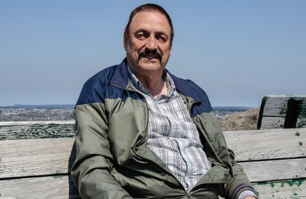 Wayne Murphy took a seat beneath Cabot Tower to watch ships and boats on the Atlantic Ocean.