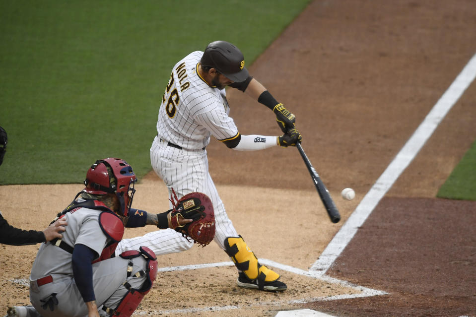 San Diego Padres' Austin Nola (26) hits a three-run home run during the third inning of a baseball game against the St. Louis Cardinals, Saturday, May 15, 2021, in San Diego. (AP Photo/Denis Poroy)