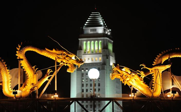 "Los Angeles City Hall is bracketed by statues of dragons in a view from Chinatown. <span class=""copyright"">(Wally Skalij / Los Angeles Times)</span>"