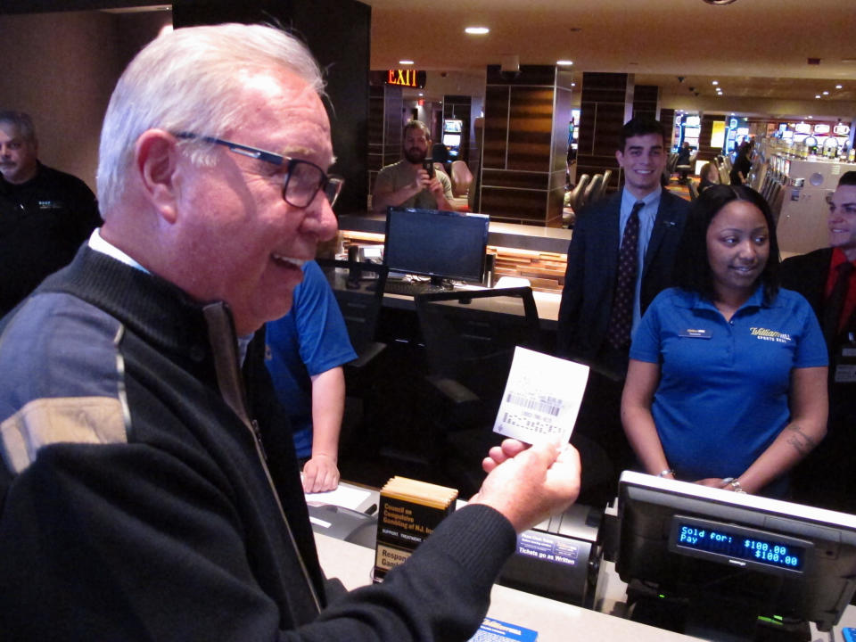 Former Philadelphia Eagles quarterback Ron Jaworski makes a sports bet at the Tropicana casino in Atlantic City, N.J. on March 8, 2019. On Wednesday, Jan. 6, 2021, New York's governor did an about-face and embraced mobile sports betting as a way to deal with financial losses from the coronavirus pandemic, and a company that tracks gambling legislation and performance predicted revenue from legal sports betting could reach $3.1 billion in 2021 and as much as $10 billion within five years. (AP Photo/Wayne Parry)