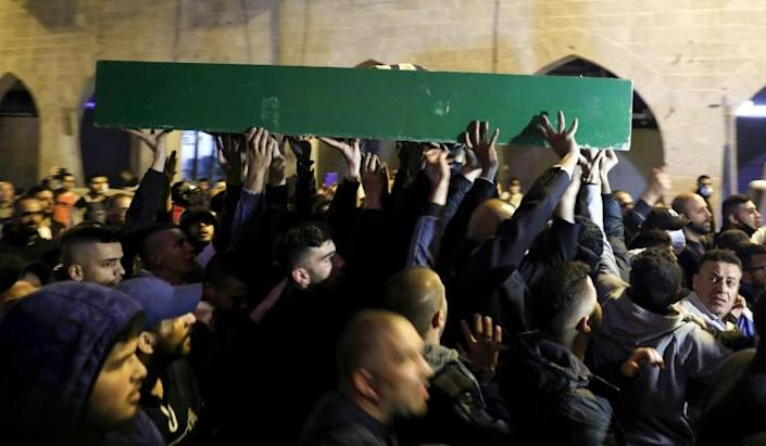 Thousands of mourners attended the funeral of Iyad Hallak (AFP Photo/AHMAD GHARABLI)