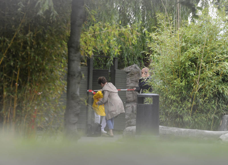 Police secure an area inside Copenhagen Zoo in Copenhagen, Denmark, Wednesday July 11, 2012, after the body of a man was found by a zoo keeper earlier Wednesday. Police say a 21-year old foreign national man who holds a Danish residence permit, was found dead inside the tiger den at the Copenhagen Zoo with his throat bitten. The man's name and nationality were not immediately released. (AP Photo/Kenneth Meyer, POLFOTO) DENMARK OUT
