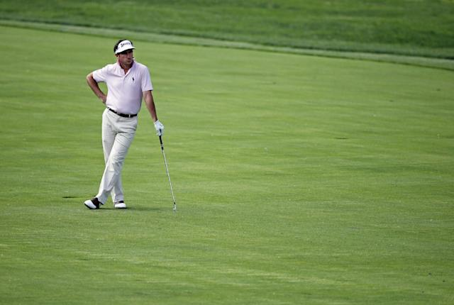 Gonzalo Fernandez-Castano, of Spain, watches his shot from the 14th fairway during the first round of the Memorial golf tournament Thursday, May 29, 2014, in Dublin, Ohio. (AP Photo/Darron Cummings)