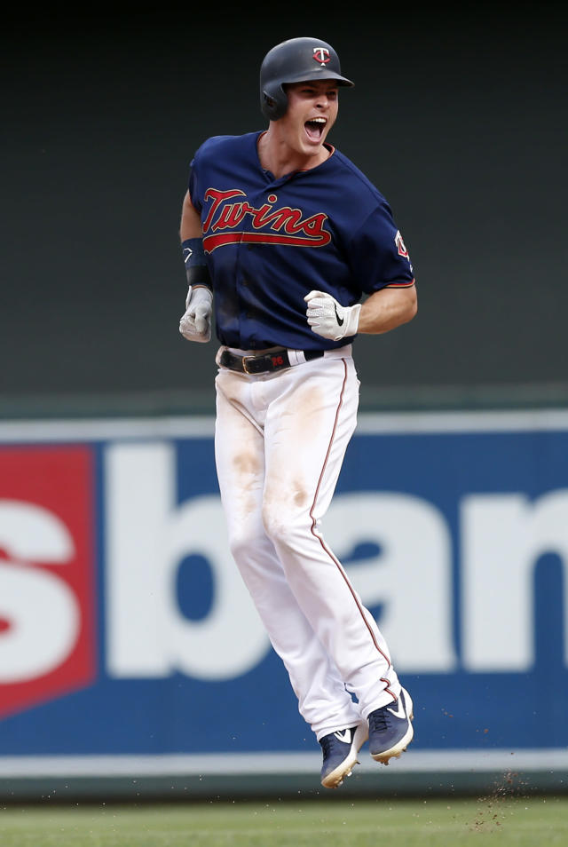 Minnesota Twins' Max Kepler celebrates his walk-off RBI single as the Twins beat the Oakland Athletics 7-6 in a baseball game Sunday, July 21, 2019, in Minneapolis. Kepler had four RBIs in the game. (AP Photo/Jim Mone)
