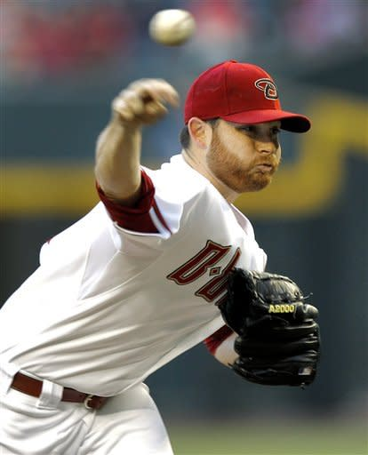 Arizona Diamondbacks pitcher Ian Kennedy delivers against the Colorado Rockies during the first inning of a baseball game, Tuesday, June 5, 2012, in Phoenix. (AP Photo/Matt York)