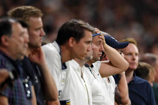 Tottenham Hotspur fans look dejected (Photo by Matthias Hangst/Getty Images)