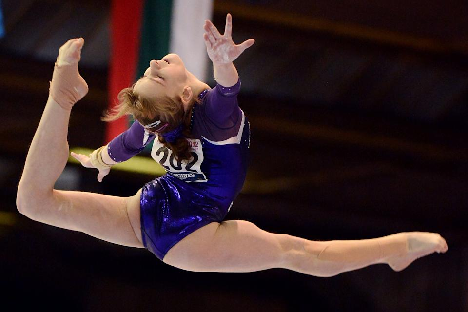 Russia's Anastasia Grishina, 16, performs on the balance beam, during the team finals at the European Women's Artistic Gymnastics Championships in Brussels, Saturday, May 12, 2012. Romania won the team final with Russia placed second and Italy placed third. (AP Photo/Geert Vanden Wijngaert)