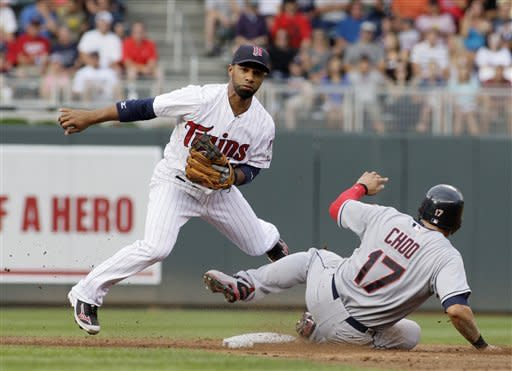 Minnesota Twins second baseman Alexi Casilla avoids the sliding Cleveland Indians Shin-Soo Choo (17) to compete the double play on a Michael Brantley grounder during the third inning in a baseball game, Saturday, July 28, 2012, in Minneapolis. (AP Photo/Paul Battaglia)