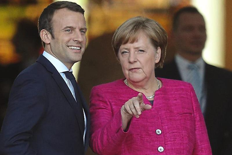 Brake: neither France's Emmanuel Macron nor Germany's Angela Merkel are inclined to speed up negotiations between the EU and Britain: Getty Images