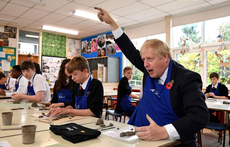 Britain's Prime Minister Boris Johnson in a school art lesson at George Spencer Academy in Stapleford on Friday (REUTERS)